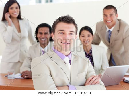 Confident Manager With Folded Arms In Front Of His Team