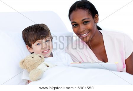 Portrait Of A Little Boy With His Doctor