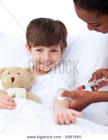 Smiling Little Boy Receiving An Injection