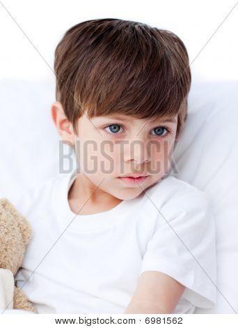 Sick Little Boy Lying In A Hospital Bed