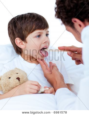 Male Doctor Checking Little Boy's Throat