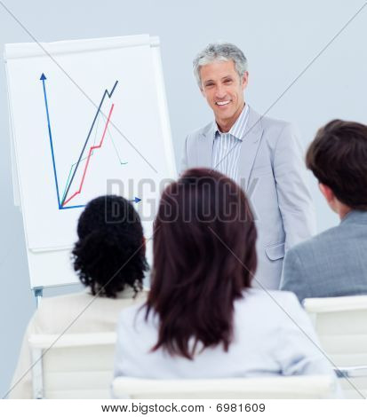 Mature Businessman Doing A Presentation