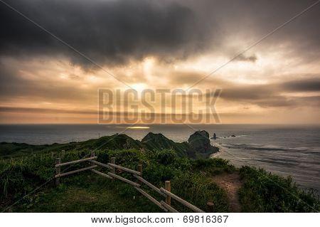 Sunlight through storm. Cape Kamui