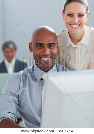 Assertive Business Partners Working At A Computer Together