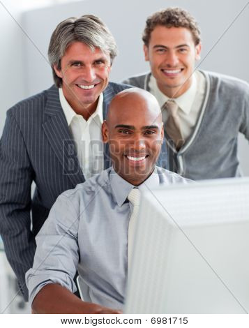 Self-assured Business Partners Working At A Computer Together