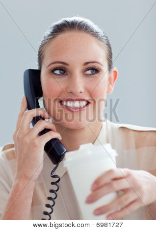 Young Businesswoman On Phone Drinking A Coffee