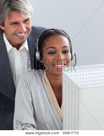 Smiling Manager Checking His Employee's Work