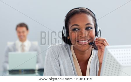 Radiant Businesswoman Using Headset At Her Desk