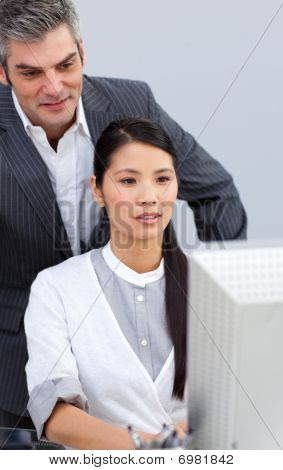 Asian Businesswoman Helping By Her Manager