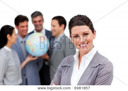 Successful Business Team Holding A Terrestrial Globe