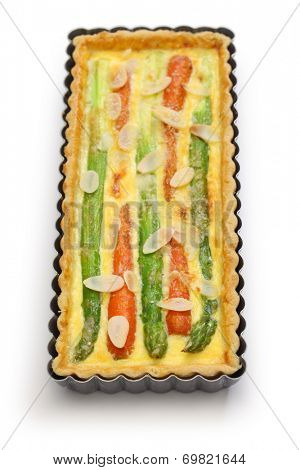 homemade vegetable quiche isolated on white background. asparagus, carrot, almond slice quiche.
