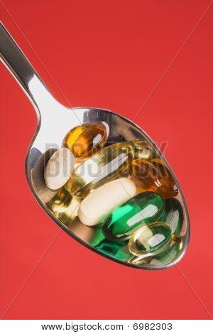 Colher de pílulas. Isolado