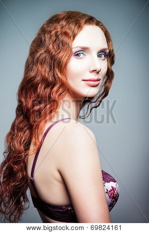 Closeup Studio Portrait Of Pretty Redhead Woman. Half-turned