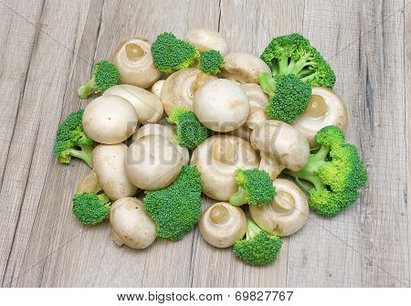 Broccoli And Mushrooms On A Wooden Background Close-up