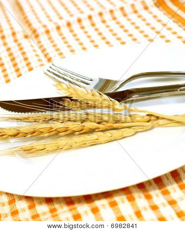 ears on white plate, fork and knife