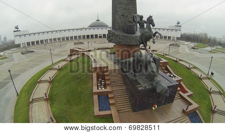 MOSCOW, RUSSIA - NOVEMBER 22, 2013: Statue of St. George at the foot of the Monument and the main building of the museum of Great Patriotic War on Poklonnaya Hill, aerial view