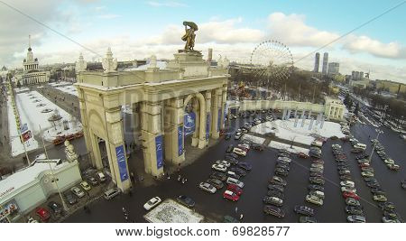 MOSCOW, RUSSIA - NOVEMBER 30, 2013: The main entrance, the Central Pavilion and parking of All-Russia Exhibition Center, aerial view. The Center conducts more than 100 exhibitions