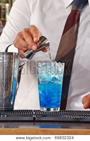 Bartender preparing blue cocktail drink. Barman preparing cocktail.drink.