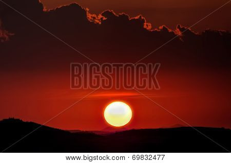 Red Sunset With Sun And Silhouette