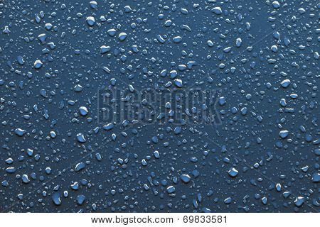 Raindrops On Blue Background
