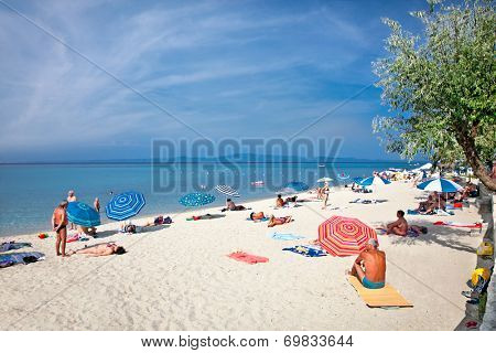 POLYCHRONO, GREECE - MAY 26, 2014 : Beautiful sandy beach on May 26. 2014 in Polychrono, Kasandra peninsula , Greece. Kasandra peninsula visit more than 200 000 European tourists every year.