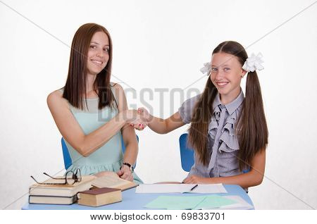 Teacher And Student Happily Shake Hands With Each Other