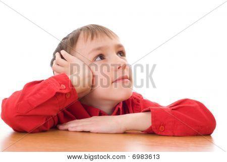 Boy Sits And Dreams