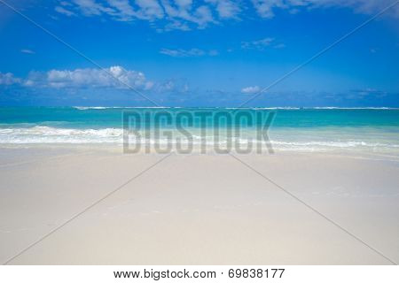 Exotic beach with white sand and the sky is blue with clouds. Dominican Republic, Punta Cana.