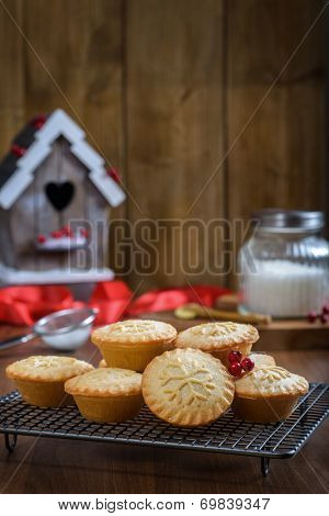 Baking at Christmas with mince pies on cooling rack