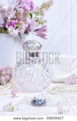 Cameo earrings on ladies dressing table with antique scent bottle in background