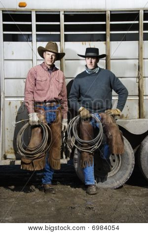 Two Men Wearing Cowboy Hats Holding Lariats