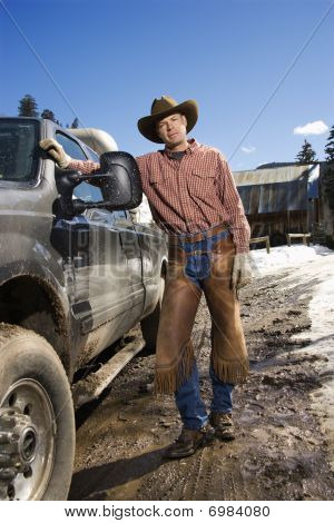 Man Wearing Cowboy Hat Standing Beside Truck