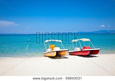 Beautiful Hanioti beach with Colorful pedalos docked on Kasandra peninsula, Halkidiki,  Greece.