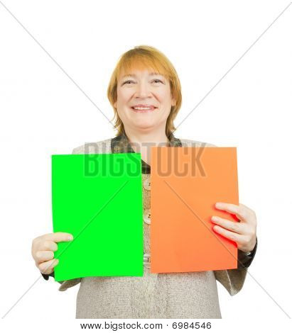 Senior Woman Holding Empty Red And Green Posters