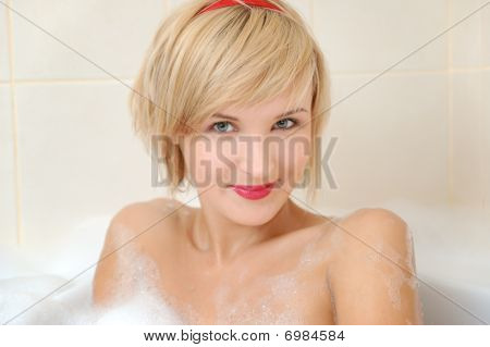 Woman Lying In Bubble Bath .