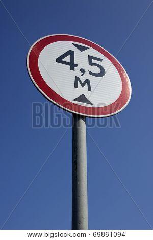 Regulatory-sign On A Road Under Blue Sky