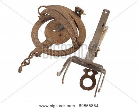 Old And Rusty Vermin Traps On A White Background.