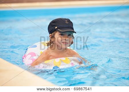 Child Swimming In The Pool