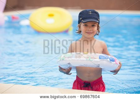 Child Standing In The Pool