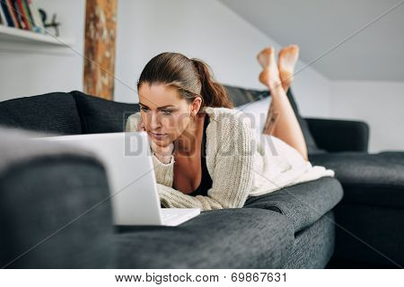 Beautiful Young Woman Working On Laptop At Home