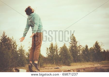 Young Man Flying Levitating or Jumping Outdoor Relax Lifestyle Happiness Spiritual Concept Retro Fil
