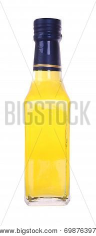 Front yellow glass liquor bottle on white background.