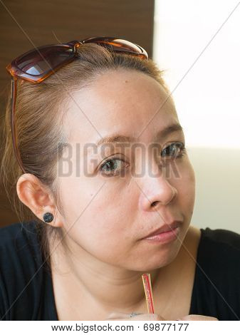 Young Asian Lady With Sunglasses Looking Into Something In Nature