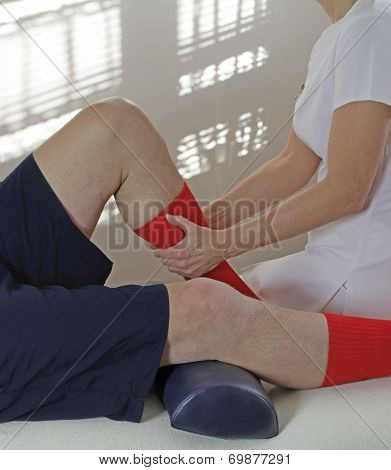 Therapist working on calf muscle