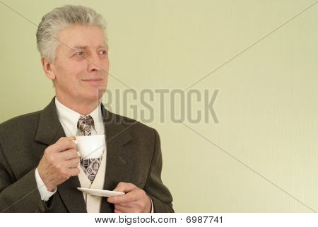 Businessman Standing With A Cup