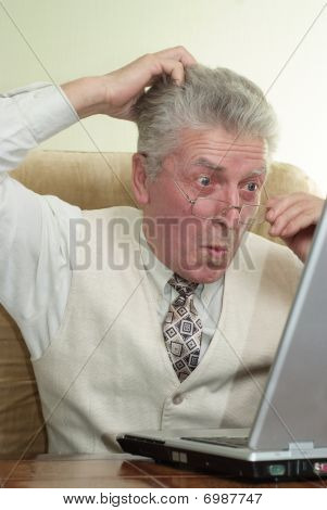 Surprised Businessman Looking At A Laptop