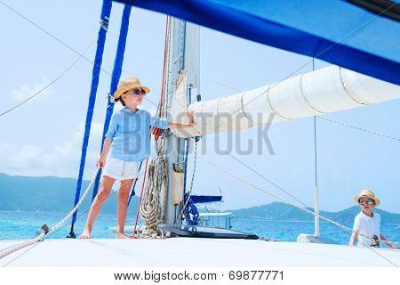 Kids enjoying sailing on a luxury catamaran or yacht