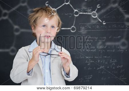 Cute pupil holding glasses against rocket science theory
