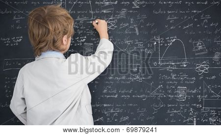 Cute pupil writing on board against math and science doodles