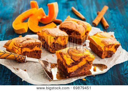 Pumpkin swirl brownies on blue wooden background